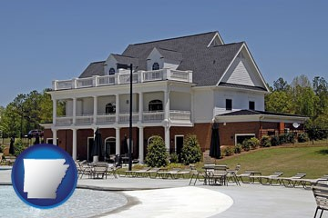 a clubhouse and pool at a country club - with Arkansas icon