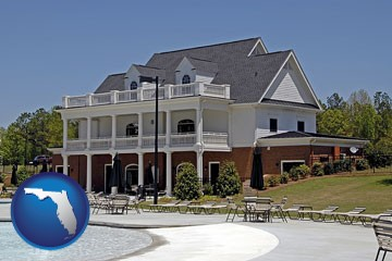 a clubhouse and pool at a country club - with Florida icon