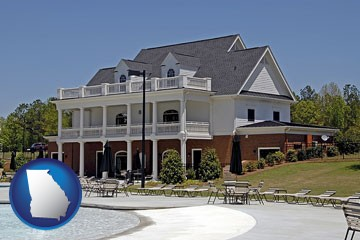 a clubhouse and pool at a country club - with Georgia icon