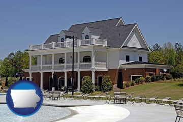 a clubhouse and pool at a country club - with Iowa icon