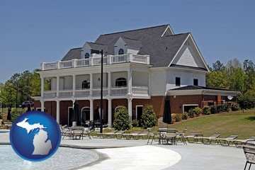 a clubhouse and pool at a country club - with Michigan icon