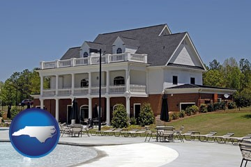 a clubhouse and pool at a country club - with North Carolina icon