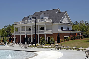 a clubhouse and pool at a country club